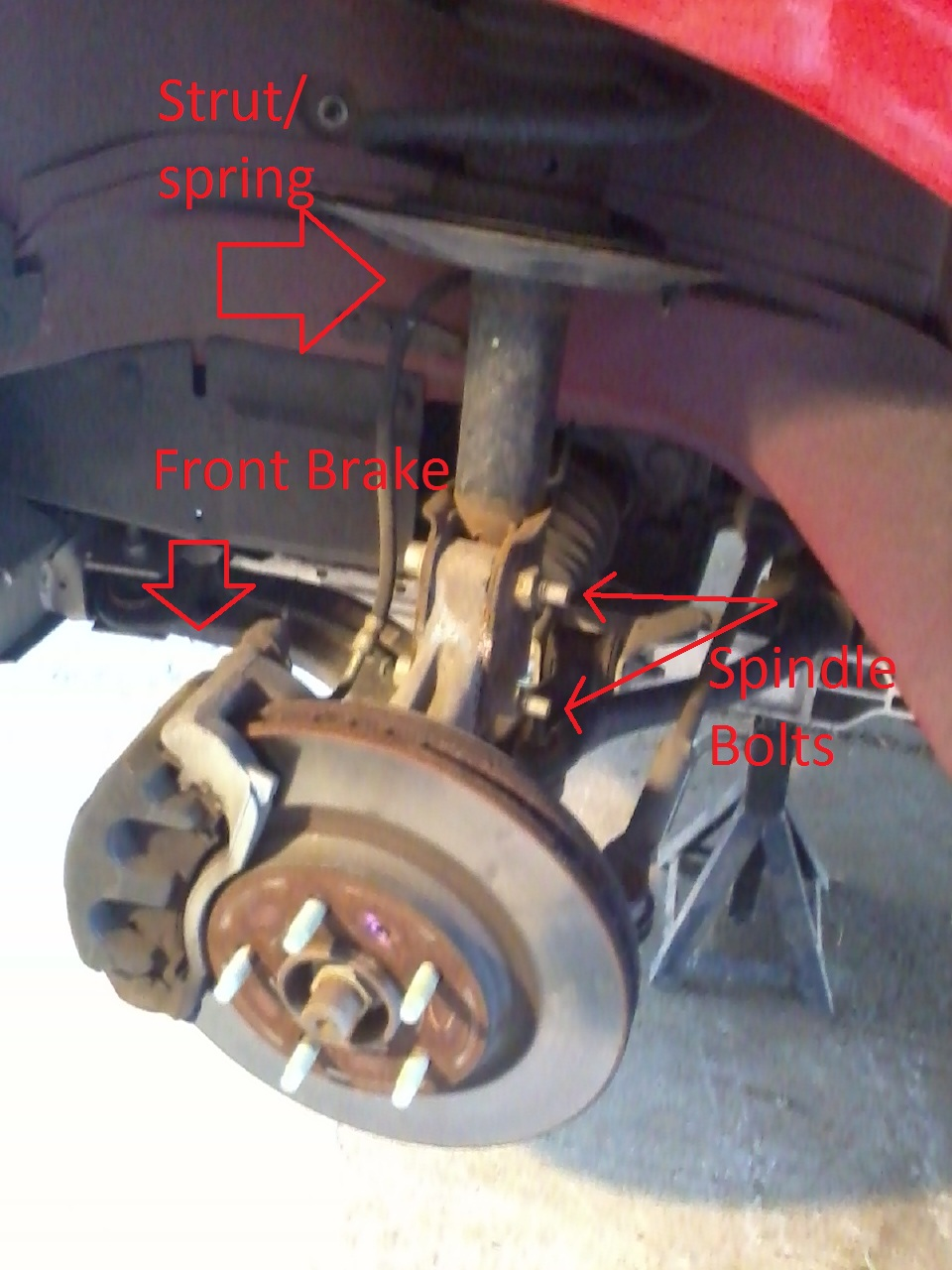 The Basics of Installing Lowering Springs-edited-front-strut.jpg